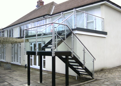 Staircase with stainless steel and glass balustrade