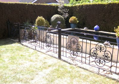 Bespoke railing with scrolled panels