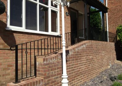 Bespoke handrail with baskets 01