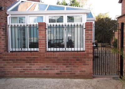 Cheshire side entrance gate and wall railing