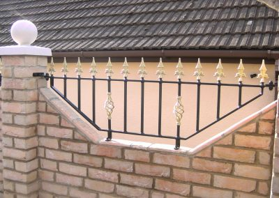 Shaped bottom Victoria wall railing with baskets heavy infill