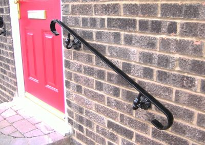 Wall handrail with ornate brackets