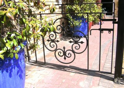 Bespoke gate with scrolled panel