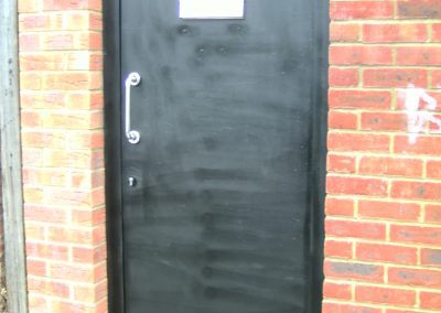 Bespoke security gate featuring handle, postbox, and signet lock