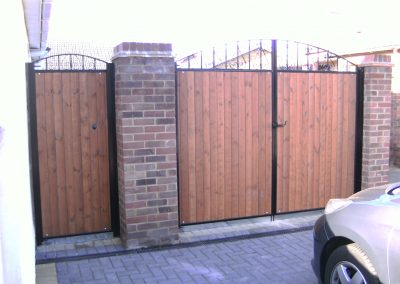 Wooden infill entrance gates (front)