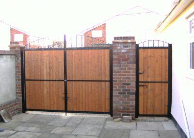 Wooden infill entrance gates (Rear)