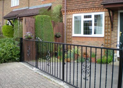 Bi-fold driveway pair with twisted bars and scrolls