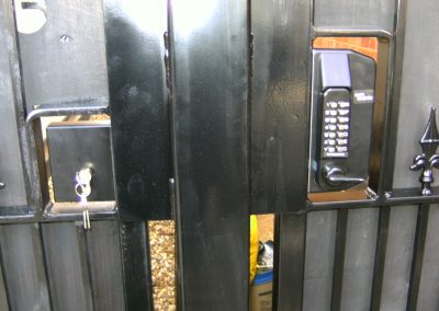 Bow top Victoria side entrance gates with signet deadlock and digital keypad