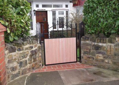Half wooden infill  bell top side gate