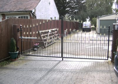Pair Victoria gates with cages and lettering incorporated