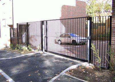 Straight bar sliding gate with railing