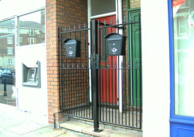 Two Victoria entrance gates with post boxes
