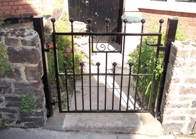 Victoria pedestrian gate incorporating house number