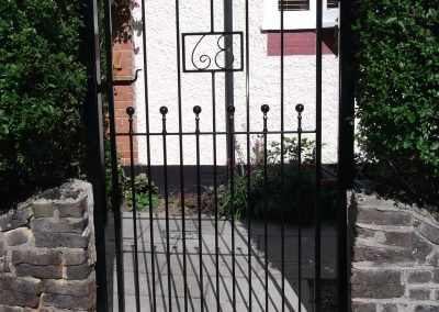 Victoria side gate incorporating house number
